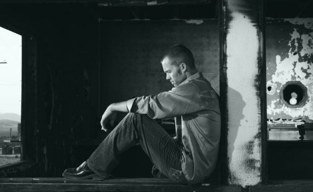 Depressed man in dark room