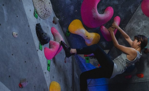 Strong woman in climbing gym