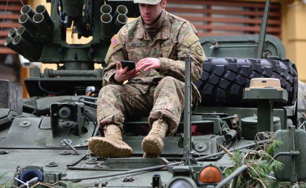 Man seated atop a tank